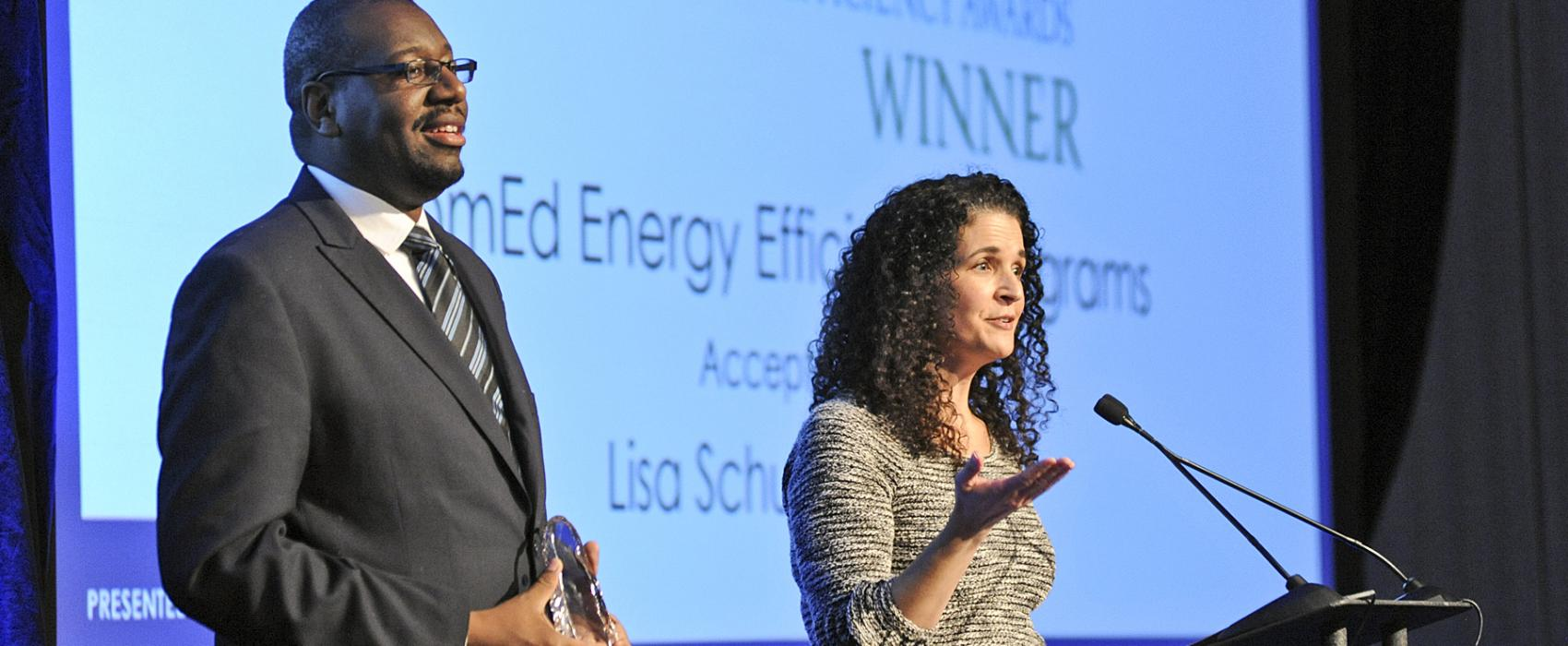 A woman speaks at a podium accepting the innovation award at the 2018 Inspiring Efficiency Awards