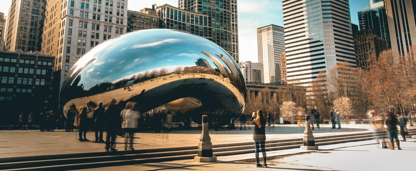 "A view of the Chicago skyline from Millenium Park with the silver ""bean"" in the foreground"